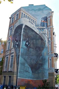 Street art on the side of a building .... ship