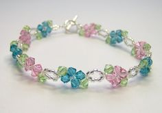 Pink and blue flower bracelet floral bracelet by BuzzybeeBeading.