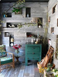built in wall shelves, plants, colors, worn wood...perfect!