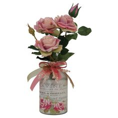 Showcasing an array of silk roses nestled in a vintage-inspired perfume bottle, this lovely faux floral arrangement brings natural elegance to your decor.