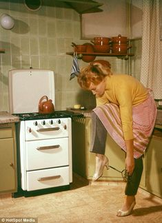 The Stepford wife workout! Vintage photos of 'perfect' Fifties wives exercising WHILE cleaning