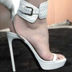 Yves Saint Laurent heels Beautiful white sandals with chain detail on heel, they are gently used. Just worn twice. Yves Saint Laurent Shoes Heels