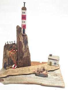 A beautiful and unique handcrafted driftwood house depicting a costal/harbour scene. All of my little scenes have been made using reclaimed wood and metals. I have taken every care to remove any splinters, due to the nature of wood please note that is not a toy and for display purposes:)
