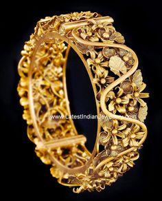 floral design broad gold bangle