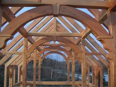 Google Image Result for http://www.vermonttimberworks.com/Web-Photos/Timber-Frame/Copy%2520of%2520Arched-Timber-Corbel.JPG