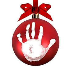 $10, buybuybaby.com Give Pearhead's ball ornament your baby's personal touch with an imprint of her tiny hand. The crafty kit also includes a pen to write your little one's name on the other side.   - BestProducts.com