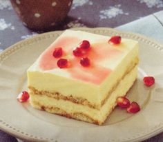 cake alla melagrana - Pomegranate cake, that is: a cake with a very discreet drizzle of red alchermes, ornamented with a sprinkling of pomegranate seeds
