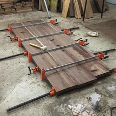 The rubber mallet used to marry the boards together while being clamped gives perspective to the scale of this headboard. The clamps will stay in place for 24 hours to ensure the glue bond sets.