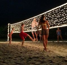 String lights on a volleyball net at night, Perfect for an end of the school year party celebration!