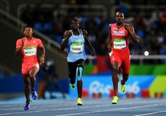 RIO DE JANEIRO, BRAZIL - AUGUST 12: Julian Jrummi Walsh of Japan, Baboloki Thebe of Botswana, Lalonde Gordon of Trinidad and Tobago during the Men's 400m Round 1 on Day 7 of the Rio 2016 Olympic Games at the Olympic Stadium on August 12, 2016 in Rio de Janeiro, Brazil. (Photo by Shaun Botterill/Getty Images)