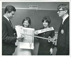 This photograph depicts four unidentified people at an American Cancer Society training. Based on the No Smoking sign above them, I feel comfortable saying this training was being held in Gary, IN. It is undated, but I would estimate it's from the early 1970s. From my personal collection.