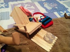 adirondack type chair for AG doll just paint to your liking. Used large Popsicle sticks and hot glue.
