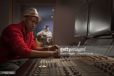 Stock Photo : African American man working at audio control panel