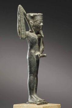 A Statuette of the Fecundity God Min.  Egypt, 26th to 30th Dynasty, 6th-4th CEntury B.C .A  تمثال صغير للخصوبة  امين كمب ين. مصر، 26 إلى 30 سلالة، 6-4TH القرن قبل الميلاد.