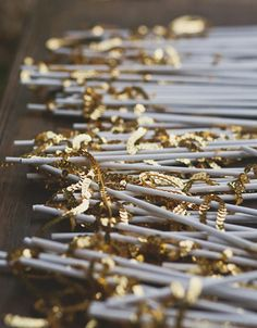 hand out gold sparkly sequin wands for guests instead of confetti or rice