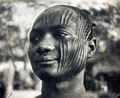 Africa | Sara man with traditional scarification.  Fort Archambault. Chad.  ca, 1931 | Scanned postcard image.