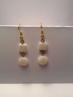 Gold and white dangle earrings by Shaylasjewelrybox on Etsy