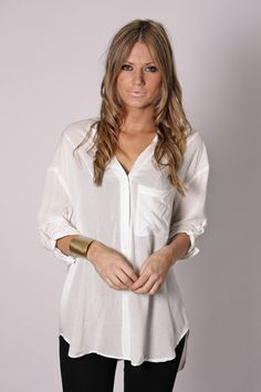 classic white flowy top with v back detail