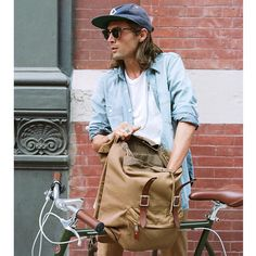"""J.Crew on Instagram: """"By bike: Graphic designer Blair takes the Harwick backpack on his afternoon bike ride from the office to band practice. See more at jcrew.com/blog."""""""