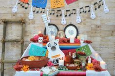 Create a Pixar Coco inspired celebration! Fun banners and garlands made easily with #Cricut. You'll see ways we added activities that bring awareness to your family line and even a way to create some beautiful art. #cricutmade