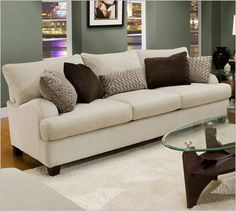 white sofa with brown accent pillows