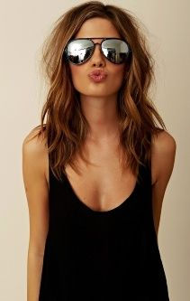 Medium length brown hair. think i'm gonna get her color and cut.