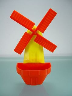 Vintage Red & Yellow Plastic Windmill Wall Pocket from jdglass on Ruby Lane