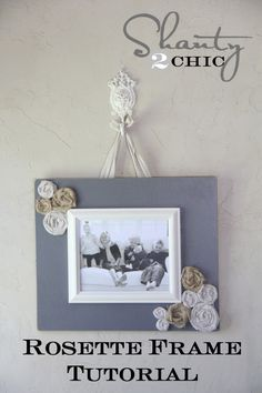 Shanty 2 Chic Frame ~ Spray painted MDF, clothe rosettes and an empty (spray painted) pic frame. Ribbon staples to the back to hang ~ love it. Spray Paint Colors: Rustoleum, grantite and heirloom white.
