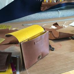 The Making of the small leather satchel with a mustard yellow lining. And a new feature! Can you see it? It's a tiny pocket in the divider! #leather #yellow #satchelbag #handmade