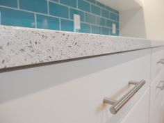 White Cambria quartz countertops + sleek flat-front cabinets + turquoise subway tile = one A+ kitchen remodel.
