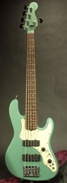 Fender Japan still offers this 5 string electric bass Roscoe Beck signature model in stores. I've not played one but love the beefier sound of the fatter bridge pickup.