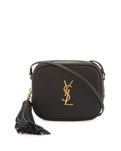 "Saint Laurent smooth calfskin crossbody bag. Golden hardware. Thin shoulder strap, 23.5"" drop. Zip top closure with tassel pull. YSL logo plate at center. Back slip pocket. Interior, leather lining; f"