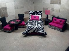"Barbie Furniture- Pink Zebra Suite Set  Includes : Barbie Bed - 12"" x 6.5""   1 Comforter   1 Bodypillow   1Sham Pillow   6"" Round Dining Table   2 Dining Chairs 3"" x 3"" x 6""   Sofa - 7"" x 3""  1 End Table 3"" x 3""   All Handmade by Nannas Barbie Furniture!"
