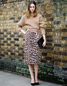 Follow Your Animal Instincts To The Fiercest Fall Look - An oversized turtleneck is an ideal mate for this curve-hugging pencil skirt. And even though each piece is a bona-fide classic, the proportions make the combo totally modern. Break up the neutral color palette with solid-black accesories and a glitzy chain belt.
