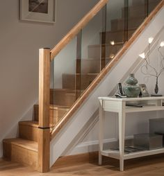 Cheshire Mouldings Reflections stair parts range creates the perfect modern staircase and includes newels, glass panels, handrails, baserails and more. New Staircase, Staircase Makeover, Staircase Remodel, Staircase Railings, Wooden Staircases, Stair Bannister Ideas, Stairs With Glass Panels, Glass Stairs, Interior Railings