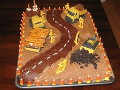 Construction Site Birthday Cake - candy corn for pylons, pretzels as logs in dump truck/trailer