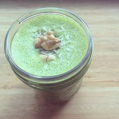 Smoothie me! Spinach, banana, shredded coconut, flaxseed, almond milk and a walnut on top for funsies.