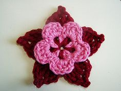 A picot flower a day keeps the blues away.  Flower pattern by SkaMama's Bone Hook.