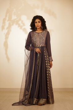 This set features a purple zardozi embroidered long kurta with dupatta and trouser. Color: Purple Fabric: Silk Chnderi Brocade And Georgette Embroidery Details: Zardozi Care: Dry Clean Only Anarkali Gown, Purple Fabric, Indian Ethnic Wear, Indian Fashion, Women Wear, Sari, Gowns, Couture, Body Measurements