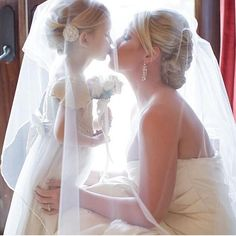 How cute is this flower girl and bride photo?