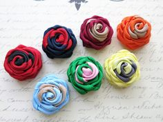 This unique Duo Rose adds a perfect touch to any attire. Each flower is hand rolled with great attention to details and hand stitched to perfection, making it a lasting fashion accessory. Made in the USA. This listing is for one (1) flower with your choice of color and backing.  Color : available in 8 colors, see chart in the 4th picture Pattern : duo colors Fabric : premium grosgrain ribbon Dimension : 1.25 (3.17 cm) diameter, 0.75 (1.90 cm) depth Backing : choose from button, military…