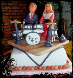 fondant wedding cake with drums and gumpaste bride and groom