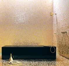 Bisazza Peonia glass mosaic tiles. Yellow-gold tiles mixed with powder-pink background tiles.