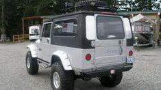 1984 Jeep CJ-8 Scrambler   F130   Seattle 2014 1997 Jeep Wrangler, Jeep Cj, Jeep Scrambler, Vintage Air, Military Vehicles, Seattle, Auction, Van, Roads