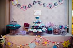 Above the desserts hung a beautiful garland of pictures of the birthday girl- one pic for every month of her first year! :)