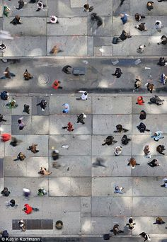 "New Yorkers rushing about | ""Madison Boogie Woogie"" by Katrin Korfmann with Pin-It-Button on http://www.dailymail.co.uk/news/article-2257487/Birds-eye-view-life-Breathtaking-pictures-shot-capture-bustle-Manhattan-Pamplonas-running-bulls-colorful-Indian-festival.html"