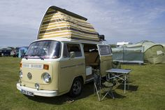 The campervan is equipped with a 'pop-up' roof which is raised during camping. She seats & sleeps 5. With the holidays approaching; it's time to starting thinking what you're going to do for this summer. Why not treat yourself & the children to a weekend away in a VW campervan. Is there a cooler way to explore the back roads of England than in a Classic Volkswagen Camper Van? Hire one of our colourful iconic campervans & you are free to drive & sleep just about anyway.