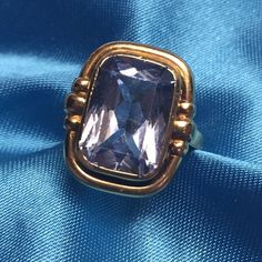 """14K Vintage Blue Topaz Bezel Ring Vintage rectangular cushion cut blue topaz bezel set in solid 14K yellow gold. Stone measures 15mm X 10mm, with bezel it's 19mm X 17mm (24mm = 1 inch). Hallmarked """"585"""" - a British hallmark for 14K.  Some minor abrasions to the top facets of stone. Not noticeable unless inches away and looking for them, price reflects that. Substantial weight at 8 grams. SIZE 6.5 easily sized by your jeweler.  ***EXCLUDED FROM ANY Bundle Sale*** You can still use the Offer…"""