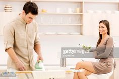Stock Photo : Couple in the kitchen.
