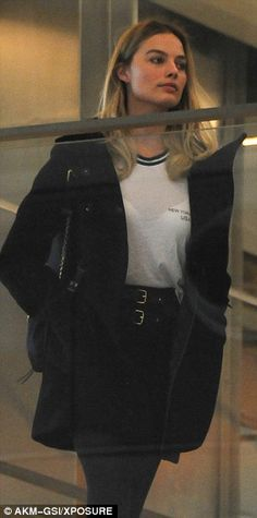 Blonde beauty: Margot wore her golden locks out in a tousled wave, and completed her look ...